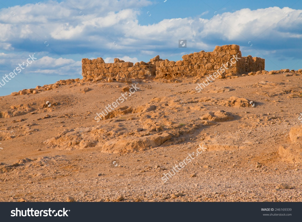 stock-photo-ruined-fort-wall-at-massada-fortress-in-negev-desert-israel-246169339