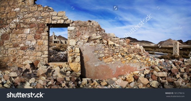 stock-photo-the-wall-and-window-of-a-crumbling-and-ruined-building-at-rhyolite-nevada-an-abandoned-town-near-181279616